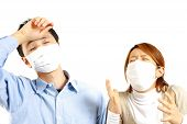 image of rhinitis  - portrait of Japanese Couple suffers from allergic rhinitis - JPG