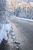stock photo of icy road  - Winter road through icy forest covered in snow after ice storm and snowfall - JPG