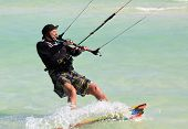 Man riding his kiteboard. Cayo Guillermo in Atlantic Ocean.