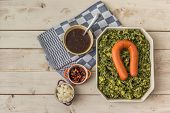 foto of kale  - Typical dutch dish boerenkool with kale mashed potatoes sausage and bacon - JPG