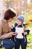 Young Mother Woman Girl And Baby Kid Son Talking On Autumn Background
