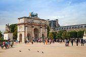 Tourists Walk Near The Triumphal Arch. Paris, France