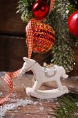 Christmas Decoration With Rocking Horse Toy On Wooden Background