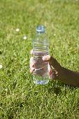 Open Water Plastic Bottle In Hand