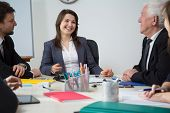 Businesswoman Laughing During Business Meeting