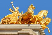 Golden statue on Cascada fountain in Barcelona