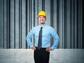 smiling worker and concrete background