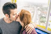 Couple On A Panoramic Wheel