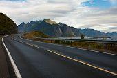 stock photo of lofoten  - view of an empty winding road at the Lofoten islands - JPG