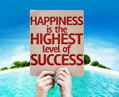 Happiness is the Highest Level Of Success card with a beach on background