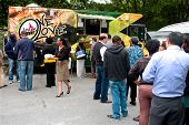 Customers Stand In Long Line To Order From Food Trucks