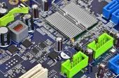 picture of microprocessor  - Printed computer motherboard with microcircuit close up DOF - JPG