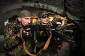 Portrait of soldiers with an automatic assault rifles