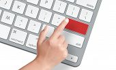 picture of reboot  - Female hand touching into blank key on keyboard - JPG