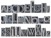 English alphabet - a collage of 26 isolated letters in letterpress metal type printing blocks, a variety of mixed fonts