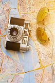 Photography, vintage. Retro camera with sunglasses