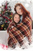 Festive mother and daughter wrapped in blanket against christmas theme frame in silver