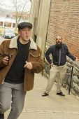 pic of immoral  - Hoodlum steals wallet from balding bearded business man  - JPG