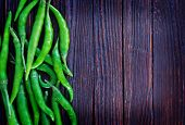 stock photo of chillies  - chilli peppers on the wooden table hot chilli