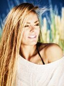 pic of dune grass  - Young woman female model posing outdoor on background of dunes sky and grass - JPG