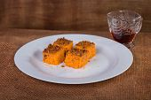 foto of carrot  - dessert. carrot cake. Carrot cake on a plate, on a brown background. ** Note: Soft Focus at 100%, best at smaller sizes - JPG