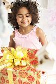 foto of mulatto  - Cute mulatto girl holding a gift - JPG