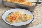 image of crust  - Potatoes a la dauphinoise on a plate - JPG