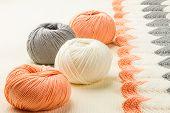 pic of knitting  - rolls of soft knitting yarn and knitting on white background - JPG
