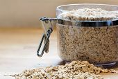 image of porridge  - rolled porridge oats in a glass jar copy space - JPG