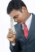 image of indian currency  - Indian business man holding indian money with expression - JPG