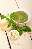 foto of pesto sauce  - Italian traditional basil pesto sauce ingredients on a rustic table - JPG