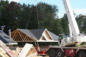 pic of trussle  - lifting roof of modular home off foundation to proceed building walls and second floor and then will be put back on - JPG