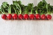 stock photo of radish  - Vegetarian healthy eating raw radishes on rustic wooden background - JPG