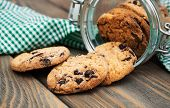 pic of cookie  - Jar with Chocolate cookies on a wooden background - JPG