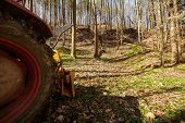 pic of logging truck  - Logging tractor with an anchor winch in the forest - JPG