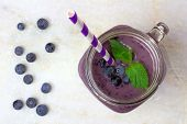 foto of mason  - Blueberry smoothie with mint in mason jar glass with straw - JPG