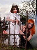 picture of madman  - Zombie  woman and child in the old cemetery in the fog - JPG