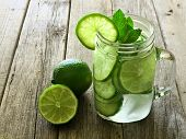 pic of masonic  - Detox water with lime and cucumbers in a mason jar against a rustic wood background - JPG