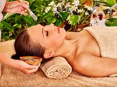 picture of beauty parlour  - Beautiful girl having clay facial mask apply by beautician - JPG