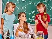 foto of chemistry  - Child and teacher holding flask in chemistry class - JPG