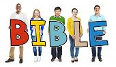 stock photo of bible story  - Multiethnic Group of People Holding Letter Bible - JPG