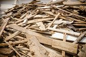 foto of lumber  - Pile of old and dirty lumber in construction site - JPG