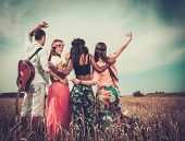 picture of hippy  - Multinational hippie friends with guitar in a wheat field  - JPG