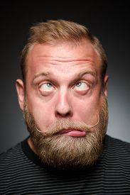 pic of fool  - Portrait of fooling bearded man on black - JPG