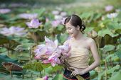 Постер, плакат: Woman With Lotus Flower
