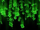 3D illustration of falling shamrock leaves Saint Patrick's day symbol isolated on black background