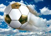 Golden soccer ball flying under blue summer sky 3D Illustration