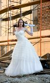 bride in white dress with saw