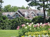 stock photo of cape-cod  - Charming Cape Cod home and gardens in Hyannis Massachusetts.