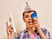 Repair home woman holding paint roller for wallpaper. Female in newspaper cap with brush renovation  poster